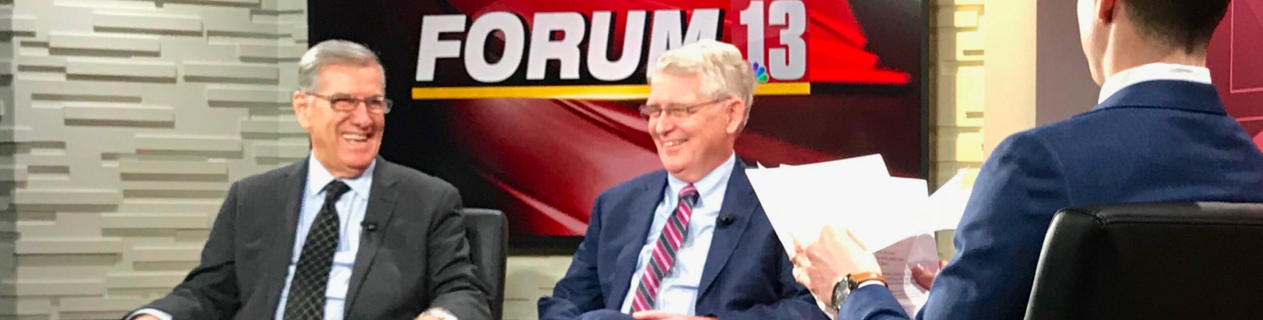 Left to right: Dr. Rashid and President Dewey laughing on the news